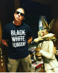 Memes, Sorry, and Black: BLACK.  HUMAN! I think the wiley e. Coyote is upset with my shirt. It says human not coyote. Sorry bro go back to catching road runners. DoinWhatIDo Eracism GetSome