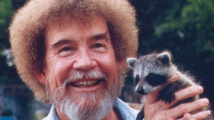Bob Ross with a friendly little racoon.: Bob Ross with a friendly little racoon.