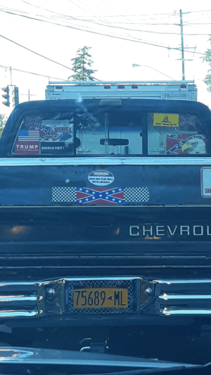 This dude driving through my town...: BONT TREAD Gl KE  REBEL  TRUMP AMERICA FIRST!  WARNING  BOLS KOT PLAY WIu  ITH LIBIRALS  **  SO  *  CHEVROL  75689-ML This dude driving through my town...