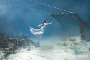 Girl, Ocean, and Com: BRETTSTANLEYPHOTO.COM A girl takes a stand underwater to stop ocean trawling in its tracks
