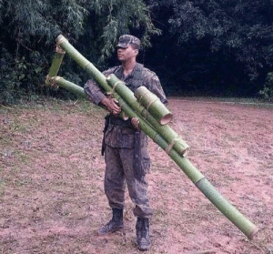 Army, British, and Japanese: British Army recruit displays captured Japanese anti tank rifle in Burma (1942, colorized)