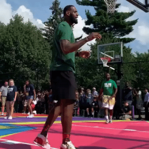 "Nike, School, and Air: Bron pulled out the ""Jerry Rice"" Nike Air Trainer 1s to unveil a new court at I Promise School 👑 @kingjames 📹 @joelmkatz"