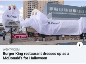 2 5: BU  McDowds  B00000!  McDONALD'S  HAPPY HALLOWEEN  2 5  DaVE TH  WGNTV.COM  Burger King restaurant dresses up as a  McDonald's for Halloween
