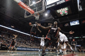 📷 Morry Gash  #WorldPhotographyDay https://t.co/wZtj9cV5Pj: BUCKS  bucks.com WORK  State Farm  State Fam  HEAT  FRONTIEK  MUTUAL of OMAHA MUTUAL of OAA MTw of 📷 Morry Gash  #WorldPhotographyDay https://t.co/wZtj9cV5Pj