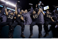Army players celebrate in the bleachers after defeating the Navy 17-10 on Saturday in an NCAA football game.: BUD  LIGHT  40  (AP Photo/Matt Rourke) Army players celebrate in the bleachers after defeating the Navy 17-10 on Saturday in an NCAA football game.