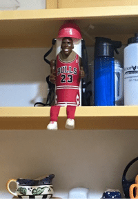 Look who I found while cleaning up my pantry.  Michael Jordan beer can holder necklace!   Quick! Someone invite me someplace that's appropriate for me to wear him.   Oh, who am I kidding?  Michael Jordan beer can holder necklace is appropriate for ALL OF THE THINGS.  But for now I'm gonna keep him up on this perch so he can be a part of the exciting pantry action.   Maybe he can tell me when I'm running out of things and whatnot.   Michael Jordan beer can holder necklace can do it all.: BULLS  23 Look who I found while cleaning up my pantry.  Michael Jordan beer can holder necklace!   Quick! Someone invite me someplace that's appropriate for me to wear him.   Oh, who am I kidding?  Michael Jordan beer can holder necklace is appropriate for ALL OF THE THINGS.  But for now I'm gonna keep him up on this perch so he can be a part of the exciting pantry action.   Maybe he can tell me when I'm running out of things and whatnot.   Michael Jordan beer can holder necklace can do it all.