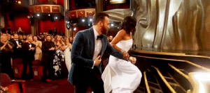 "bundibird:  wrangletangle:  stevenrogered: Chris Evans helps Regina King up the stairs to the stage after her Oscars win Okay listen up, all you dudes out there! It's time for some life lessons from Chris Evans. Wonder why women are fine with this when he does it, but they find you opening a car door or offering to carry stuff for them annoying? Well, wonder no more! It works like this: A large number of women have had to learn how to dodge and swerve and sometimes even slap away men's hands from the time they hit puberty - and sometimes before. Ladies, cis and trans both, are unfortunately experienced at being groped, poked, prodded, ""helped"", and otherwise humiliated and threatened by men. Then also there's the condescending attitude that of course we need a man's help, and we should be grateful he offered it.  No thanks. Chris is doing something very different here, and you'll see it in similar video clips of him at other events. You can read his mental process in his body language. He starts with just clapping and congratulating. He offers nothing until there is a need, which doesn't happen here until Regina's shoe gets caught on her dress. Since women have literally tripped up the stairs at this ceremony several times over the years (because the shoe and clothing requirements are ridiculous), it is reasonable at this stage to think that my-shoe-caught-on-my-dress is a problem that actually needs to be addressed. This is when Chris offers. How he offers matters. He starts with an open hand toward her, but this is a big no-no. Open hands are a red flag. Open hands grope and grab and shove. He quickly corrects by flipping his arm over and offering his forearm instead. This makes it her choice whether to grab on or ignore him. She doesn't have to contend with a potentially threatening hand while she's also contending with her dress.  He also bends down a bit to do this. I don't know if you've noticed, but Chris is kind of a tall, beefy guy. Guys like that can be a bit intimidating without meaning to be, at least when they're up close. Also, his arm is a bit too high to be useful to her if he stays at his full height. So he bends down. This is even more visible in the video from him doing this for Betty White at the 2015 Oscars, because she's shorter than Regina, I guess. He offers his arm for exactly as long as she leans on it. When she lets go, he steps back. This is a guy who isn't interested in showing off how much she needs his help. He's just interested in helping, and when he's not needed, he's done. He goes back to sit down. He doesn't hover. Also, Regina King knows who Chris Evans is. His behavior at work thus far has certainly made it into the rumor mill, thus factoring into whether she accepts help from him. Is he a dudebro or jerk to women at work? That doesn't appear to be the case. Women are not helpless. Compared to men, our clothes are more often obstacles to getting where we need to go safely and with our dignity intact, but conversely, we've also learned to deal with that better than most men have. It's not that we never need or want help; like all people, we do sometimes need a hand. It's just that ""some kinds of help are the kinds of help we all could do without."" If you are offering help to a woman, first make sure she actually appears to be struggling. Second, make yourself as unthreatening as possible and let her do any touching, not the other way around. Third, make sure she can refuse without any consequences. And fourth, back off as soon as she doesn't need you anymore and let the moment go.   I hadn't even registered why exactly it was that he was so unthreatening in this and the Betty White assistance incidents, but you're right. It's all in the way he helps. It's not that this is unthreatening behaviour ""because he's Chris Evans"" – its because his body language is genuinely unthreatening and merely helpful.  A+ analysis – I hadn't even registered the details of why and how this behaviour was 100% ok, while from another man (who probably would have gone about it differentky) it might not have been   : bundibird:  wrangletangle:  stevenrogered: Chris Evans helps Regina King up the stairs to the stage after her Oscars win Okay listen up, all you dudes out there! It's time for some life lessons from Chris Evans. Wonder why women are fine with this when he does it, but they find you opening a car door or offering to carry stuff for them annoying? Well, wonder no more! It works like this: A large number of women have had to learn how to dodge and swerve and sometimes even slap away men's hands from the time they hit puberty - and sometimes before. Ladies, cis and trans both, are unfortunately experienced at being groped, poked, prodded, ""helped"", and otherwise humiliated and threatened by men. Then also there's the condescending attitude that of course we need a man's help, and we should be grateful he offered it.  No thanks. Chris is doing something very different here, and you'll see it in similar video clips of him at other events. You can read his mental process in his body language. He starts with just clapping and congratulating. He offers nothing until there is a need, which doesn't happen here until Regina's shoe gets caught on her dress. Since women have literally tripped up the stairs at this ceremony several times over the years (because the shoe and clothing requirements are ridiculous), it is reasonable at this stage to think that my-shoe-caught-on-my-dress is a problem that actually needs to be addressed. This is when Chris offers. How he offers matters. He starts with an open hand toward her, but this is a big no-no. Open hands are a red flag. Open hands grope and grab and shove. He quickly corrects by flipping his arm over and offering his forearm instead. This makes it her choice whether to grab on or ignore him. She doesn't have to contend with a potentially threatening hand while she's also contending with her dress.  He also bends down a bit to do this. I don't know if you've noticed, but Chris is kind of a tall, beefy guy. Guys like that can be a bit intimidating without meaning to be, at least when they're up close. Also, his arm is a bit too high to be useful to her if he stays at his full height. So he bends down. This is even more visible in the video from him doing this for Betty White at the 2015 Oscars, because she's shorter than Regina, I guess. He offers his arm for exactly as long as she leans on it. When she lets go, he steps back. This is a guy who isn't interested in showing off how much she needs his help. He's just interested in helping, and when he's not needed, he's done. He goes back to sit down. He doesn't hover. Also, Regina King knows who Chris Evans is. His behavior at work thus far has certainly made it into the rumor mill, thus factoring into whether she accepts help from him. Is he a dudebro or jerk to women at work? That doesn't appear to be the case. Women are not helpless. Compared to men, our clothes are more often obstacles to getting where we need to go safely and with our dignity intact, but conversely, we've also learned to deal with that better than most men have. It's not that we never need or want help; like all people, we do sometimes need a hand. It's just that ""some kinds of help are the kinds of help we all could do without."" If you are offering help to a woman, first make sure she actually appears to be struggling. Second, make yourself as unthreatening as possible and let her do any touching, not the other way around. Third, make sure she can refuse without any consequences. And fourth, back off as soon as she doesn't need you anymore and let the moment go.   I hadn't even registered why exactly it was that he was so unthreatening in this and the Betty White assistance incidents, but you're right. It's all in the way he helps. It's not that this is unthreatening behaviour ""because he's Chris Evans"" – its because his body language is genuinely unthreatening and merely helpful.  A+ analysis – I hadn't even registered the details of why and how this behaviour was 100% ok, while from another man (who probably would have gone about it differentky) it might not have been"