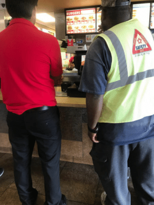 Homeless, Jack in the Box, and Houston: BURGERS Jack in the box worker telling a homeless guy to get whatever he wants to eat. (Yes, homeless people in Houston have vests for some reason)