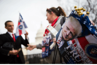 Gina Williams of Tennessee sells DonaldTrump memorabilia at the U.S. Capitol the day before he is inaugurated as president. Trump45: c  0 7V3S  RE  45 L 1  2  ,Jan Gina Williams of Tennessee sells DonaldTrump memorabilia at the U.S. Capitol the day before he is inaugurated as president. Trump45