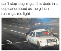 the grinch: can't stop laughing at this dude in a  cop car dressed as the grinch  running a red light