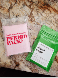maxi pad: CARDS AGAINST HUMANITY  1.6 OZ  Weed  Pack  Cards Against Humanity  PERIOD  TYPE  □ INDICA  47  □ HYBRID  WARNING  Th  is product  actual marij  does not contain any  ana. We smoked it all