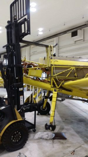 A ratchet straps and vice grips to lift the aircraft.: CAT A ratchet straps and vice grips to lift the aircraft.
