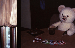 nirvanah:My dad gave me a USB drive with hundreds of pictures he has taken since the 70′s. This picture of the Snuggle bear playing UNO is undoubtedly the best picture he has ever taken.: CEDS nirvanah:My dad gave me a USB drive with hundreds of pictures he has taken since the 70′s. This picture of the Snuggle bear playing UNO is undoubtedly the best picture he has ever taken.
