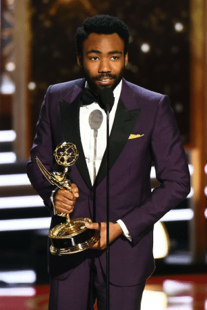Donald Glover, Microsoft, and Tumblr: celebsofcolor:Donald Glover accepts the Outstanding Directing for a Comedy Series award for 'Atlanta' onstage during the 69th Annual Primetime Emmy Awards at Microsoft Theater on September 17, 2017 in Los Angeles, California.