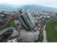 Memes, News, and Earthquake: Cerbral News Agency vis AP A residential building leans on a collapsed first floor following an earthquake in Hualien, southern Taiwan. Crews continue to try to rescue people from damaged buildings after a strong earthquake hit Taiwan, killing at least four people.