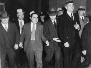Head, New York, and Supreme: Charles 'Lucky' Luciano (center right, head down) Leaving New York Supreme Court, 1936