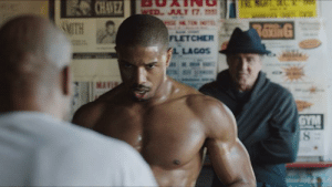 In the movie Creed (2015), Adonis Creed gets really nervous and has to take a shit right before his first big fight. This is actually a reference to the r/shittymoviedetails sub itself. As the movie predates this sub, Creed is also the first movie in the Rocky franchise to feature time travel.: CHAVEZ  SMITH  WED JULY 17.  RaxinG  FLETCHER  A LAGOS  MA  GYM In the movie Creed (2015), Adonis Creed gets really nervous and has to take a shit right before his first big fight. This is actually a reference to the r/shittymoviedetails sub itself. As the movie predates this sub, Creed is also the first movie in the Rocky franchise to feature time travel.