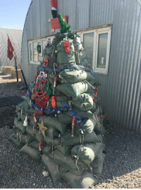 Christmas, Memes, and Afghanistan: Check out this amazing sandbag Christmas tree created by Marines deployed to Helmand province, Afghanistan. https://t.co/tfrFg4kk30