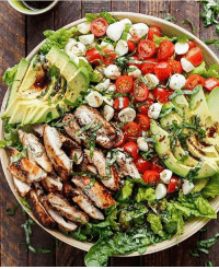 Chicken Avocado Caprese Salad Recipe By: @cafedelites . Serves: 4 Ingredients Marinade-Dressing: ¼ cup (60 mL) balsamic vinegar 2 tablespoons (30 mL) olive oil 2 teaspoons brown sugar 1 teaspoon minced garlic 1 teaspoon dried basil 1 teaspoon salt Salad: 4 chicken thigh fillets, skin removed (no bone)* 5 cups Romaine (or cos) lettuce leaves, washed and dried 1 avocado, sliced 1 cup cherry or grape tomatoes, sliced ½ cup mini mozzarella - bocconcini cheese balls ¼ cup basil leaves, thinly sliced Salt and pepper, to season Instructions: Whisk marinade ingredients together to combine. Place chicken into a shallow dish; pour 4 tablespoons of the dressing - marinade onto the chicken and stir around to evenly coat chicken. Reserve the untouched marinade to use as a dressing. Heat about one teaspoon of oil in a large grill pan or skillet over medium-high heat and grill or sear chicken fillets on each side until golden, crispy and cooked through. Once chicken is cooked, set aside and allow to rest. Slice chicken into strips and prepare salad with lettuce, avocado slices, tomatoes, mozzarella cheese and chicken. Top with basil strips; drizzle with the remaining dressing; season with salt and pepper; serve.: Chicken Avocado Caprese Salad Recipe By: @cafedelites . Serves: 4 Ingredients Marinade-Dressing: ¼ cup (60 mL) balsamic vinegar 2 tablespoons (30 mL) olive oil 2 teaspoons brown sugar 1 teaspoon minced garlic 1 teaspoon dried basil 1 teaspoon salt Salad: 4 chicken thigh fillets, skin removed (no bone)* 5 cups Romaine (or cos) lettuce leaves, washed and dried 1 avocado, sliced 1 cup cherry or grape tomatoes, sliced ½ cup mini mozzarella - bocconcini cheese balls ¼ cup basil leaves, thinly sliced Salt and pepper, to season Instructions: Whisk marinade ingredients together to combine. Place chicken into a shallow dish; pour 4 tablespoons of the dressing - marinade onto the chicken and stir around to evenly coat chicken. Reserve the untouched marinade to use as a dressing. Heat about one teaspoon of oil in a large grill pan or skillet over medium-high heat and grill or sear chicken fillets on each side until golden, crispy and cooked through. Once chicken is cooked, set aside and allow to rest. Slice chicken into strips and prepare salad with lettuce, avocado slices, tomatoes, mozzarella cheese and chicken. Top with basil strips; drizzle with the remaining dressing; season with salt and pepper; serve.