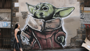 Found Baby Yoda in a laneway in Melbourne: CHICKEN  NUGGET  I WANT  MMM...  YES  AMEPUKO  СИСАЛА  BECAA,  JE CTP  AMOE  PURK UST  %23  e sun  Sining  lave Found Baby Yoda in a laneway in Melbourne