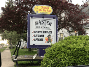 """Run, Sports, and Chicken: Chicken  On The Run  By The Piece Or Dinne  MASTER  BAIT & TACKLE  SPORTS SUPPLIES  LIVE BAIT """"  しAPPAREL That's an odd sequence of events"""