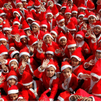 Children dressed in Santa Claus costumes wave as they participate in Christmas celebrations at a school in Chandigarh, India. Many people believe that the modern image of Santa comes from the work of Thomas Nast, an artist who drew for the magazine Harpers Weekly. He painted Santa from 1863 to 1886 and in 1869 illustrated a book called Santa Claus and His Works. The book showed how Santa manufactured toys for boys and girls at his home at the North Pole. The colours of his suit are widely thought to derive from the original Saint Nicholas, who was the Bishop of Myra in the 4th Century. Red and white were the hues of traditional bishop robes, although some historians argue that he originally dressed in different colours. PHOTO: Ajay Verma- REUTERS BBCSnapshot photography costume santa santaclaus Chirstmas: Children dressed in Santa Claus costumes wave as they participate in Christmas celebrations at a school in Chandigarh, India. Many people believe that the modern image of Santa comes from the work of Thomas Nast, an artist who drew for the magazine Harpers Weekly. He painted Santa from 1863 to 1886 and in 1869 illustrated a book called Santa Claus and His Works. The book showed how Santa manufactured toys for boys and girls at his home at the North Pole. The colours of his suit are widely thought to derive from the original Saint Nicholas, who was the Bishop of Myra in the 4th Century. Red and white were the hues of traditional bishop robes, although some historians argue that he originally dressed in different colours. PHOTO: Ajay Verma- REUTERS BBCSnapshot photography costume santa santaclaus Chirstmas
