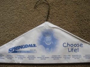 Ironic advertising.: Choose  Life!  INGDALE  SINCE 1969  cleaners  HILL  dng Rd. FAIRFI  SYMMES TWP HYDE PARK MONFORT HTS. MASON  T70-022  ELD SPRINGDALE BLUE ASH  EAST  121 Disie Hwy 241 Northland Bd 9300 Kenwood 4240 Mt. Car-Tabasoo 11900 Montgomery 3130 Wasson 3468 North Bn  Cavaler 8747880  671-6789  984-5440  528-7945  683-5124  321-7878  481-5051 Ironic advertising.
