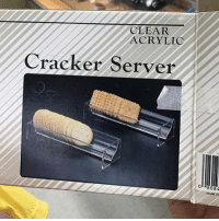Funny, Color, and Server: CLEAR  ACRYLIC  Cracker Server  8084  MADE IN There's an In Living Color joke in there somewhere...