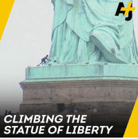 Climbing, Memes, and Protest: CLIMBING THE  STATUE OF LIBERTY This woman climbed up the base of the Statue of Liberty to protest against the separation of migrant and refugee families at the U.S. border.