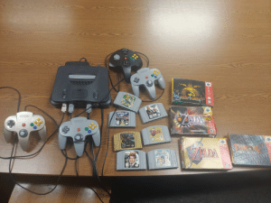 """Working at one of the oldest stations in the county. The police side is long condemned. Contractors came today to start stripping it down to the studs. Great find in a sealed tote, forgotten by time.: Colers  Mintontdo  MARKOKANE  MORIAKMBA  SOLD  CHMIDWAY  M  MADDEN  66  NINTENDO  DLITZL  THE LEGEND OF  Nintondo  ADA  SPORTS  EXPANSION PAK  REQUIRED  10  E  MIDW  MAJORA' S MASK""""  E  LDA  COLLECTOR'S EDITION  OLDA  NINTENDO  NINTENDO  NINTENDO  Only Fo  THE LEGENDOr  Seaben  OCARINA OF TIME  Aaim  TEEN  A LUS  T Working at one of the oldest stations in the county. The police side is long condemned. Contractors came today to start stripping it down to the studs. Great find in a sealed tote, forgotten by time."""