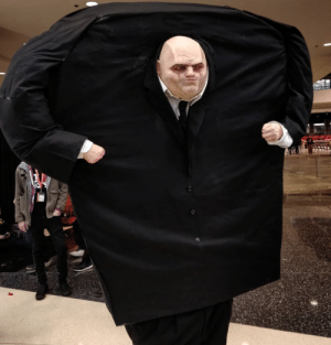 cosplayinamerica: I originally planned on doing a cosplay that allowed me to be comfortable at the convention….and then I saw Spider-Man: Into the Spider-verse. As soon as I saw Kingpin I thought, I MUST BE HIM. I fell in love with his character design and loved how absurdly large he was.   I started sculpting his face after I saw the movie but didn't start on the body until a couple weeks before the convention. I basically just built a box out of insulation foam sheets with foam pieces inside that rested on my shoulders to give him height. I cut a hole out of the belly area and covered the entire body in sheer black fabric so that I could see through it without any obvious vision holes. For the arms, I bought the largest pair of black pants I could find at the thrift shop and used them as sleeves. I stuffed them with foam and ran a wire through them so they could bend and so I could easily attach my silicone hands (which were lifecasts of my own tiny hands). I ran the face in silicone and backed it with foam. I then attached the face to the body with silicone caulk. Everything else was basically attached by hot glue and a prayer.  I tried it on for the first time a couple days before the convention and realized the insulation foam was really doing its job and within seconds I was already getting warm. So, the night before the show I ran out and bought a battery operated fan that I installed under his armpit. As much as I stressed about all the imperfections, as soon as I walked into the con and saw the reactions to it, I was immediately relieved. Seeing so many little Miles cosplayers freak out over a giant Fisk truly made my day. Doing cosplay is such an amazing creative outlet for me. I'm a full-time SFX artist, but like most jobs, I don't have any creative freedom. Cosplay gives me the opportunity to use all these crazy skills I've learned and create something that brings myself and others pure joy. —- https://www.instagram.com/dinasaurclub/ Photo : David Ngo : cosplayinamerica: I originally planned on doing a cosplay that allowed me to be comfortable at the convention….and then I saw Spider-Man: Into the Spider-verse. As soon as I saw Kingpin I thought, I MUST BE HIM. I fell in love with his character design and loved how absurdly large he was.   I started sculpting his face after I saw the movie but didn't start on the body until a couple weeks before the convention. I basically just built a box out of insulation foam sheets with foam pieces inside that rested on my shoulders to give him height. I cut a hole out of the belly area and covered the entire body in sheer black fabric so that I could see through it without any obvious vision holes. For the arms, I bought the largest pair of black pants I could find at the thrift shop and used them as sleeves. I stuffed them with foam and ran a wire through them so they could bend and so I could easily attach my silicone hands (which were lifecasts of my own tiny hands). I ran the face in silicone and backed it with foam. I then attached the face to the body with silicone caulk. Everything else was basically attached by hot glue and a prayer.  I tried it on for the first time a couple days before the convention and realized the insulation foam was really doing its job and within seconds I was already getting warm. So, the night before the show I ran out and bought a battery operated fan that I installed under his armpit. As much as I stressed about all the imperfections, as soon as I walked into the con and saw the reactions to it, I was immediately relieved. Seeing so many little Miles cosplayers freak out over a giant Fisk truly made my day. Doing cosplay is such an amazing creative outlet for me. I'm a full-time SFX artist, but like most jobs, I don't have any creative freedom. Cosplay gives me the opportunity to use all these crazy skills I've learned and create something that brings myself and others pure joy. —- https://www.instagram.com/dinasaurclub/ Photo : David Ngo