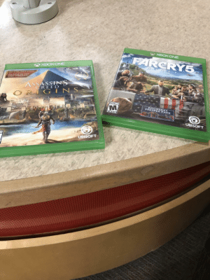 Gamestop, Ubisoft, and Best: CRY  XBOXONEE  ONUS PRE-ORDER MISSION  SECRUTS OF TH  FIRST PYRAMIDS  ASSASSINS  CREE D  G IN S  MATURE 17+  DOOMSDAY  PREPPER PACK  UBISOFT  UBISOFT Sick of GameStop's ridiculous trade-in offers, I decided to donate these to my local library instead. Best $30 I never got.