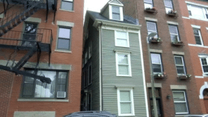 cryptid-wendigo:  The Skinny House is a spite house that was built in Boston, Massachusetts. It's a four story home that's 10 feet wide and 30 feet long and the only entrance to the building is the door at the side. The story goes that a plot of land was given to two brothers to share. When one brother returned from serving in the Civil War, he found that the other had built a large home that took up the majority of their land. The returned soldier, annoyed by what his brother had done, decided to build his spite house. He built it in a location that would disrupt his brother's view to the harbor. To this day, the house stands as a residential home. : cryptid-wendigo:  The Skinny House is a spite house that was built in Boston, Massachusetts. It's a four story home that's 10 feet wide and 30 feet long and the only entrance to the building is the door at the side. The story goes that a plot of land was given to two brothers to share. When one brother returned from serving in the Civil War, he found that the other had built a large home that took up the majority of their land. The returned soldier, annoyed by what his brother had done, decided to build his spite house. He built it in a location that would disrupt his brother's view to the harbor. To this day, the house stands as a residential home.