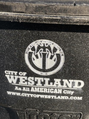 Is it just me or does the city of Westland MI's logo feature symbolism strikingly similar to a combination of the Nazi Third Reich's Reichsadler eagle, the Japanese Imperial army's Rising Sun and communist Soviet Union's hammer and sickle?: CTY OF  WESTLAND  An n AMERICAN City  W.CITTOFWESTLAND COM Is it just me or does the city of Westland MI's logo feature symbolism strikingly similar to a combination of the Nazi Third Reich's Reichsadler eagle, the Japanese Imperial army's Rising Sun and communist Soviet Union's hammer and sickle?