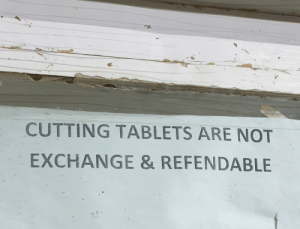 Pharmacy, Tablets, and Engrish: CUTTING TABLETS ARE NOT  EXCHANGE & REFENDABLE As seen on a pharmacy window...