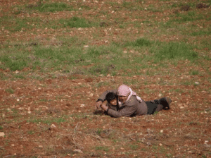 Dad trying to shield his son from an aircraft attack in Idlib, Syria: Dad trying to shield his son from an aircraft attack in Idlib, Syria