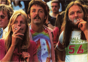 Paul McCartney, Rick Astley, and David Gilmour: DALL  WBOY Linda McCartney, Paul McCartney, and David Gilmour at a Rick Astley concert in 1988