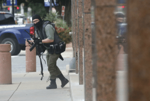 Fire, News, and Dallas: Dallas Morning News staff photographer Tom Fox captured this image shortly before a gunman opened fire on the Earle Cabell Federal Building Monday morning in downtown Dallas. Fox was waiting to enter the building to cover a trial when the attack took place.
