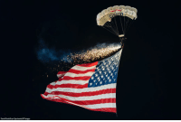 A parachutist falls into the stadium carrying the American flag before a college football game between the Notre Dame Fighting Irish and the Northwestern Wildcats on Saturday in Evanston, IL.: Daniel Bartellcon Sportswire/AP Images A parachutist falls into the stadium carrying the American flag before a college football game between the Notre Dame Fighting Irish and the Northwestern Wildcats on Saturday in Evanston, IL.