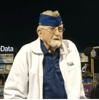 "America, Football, and God: Data  egraONE  USA  RIDGE  ia  nco What an incredible moment. 99-year-old WWII Veteran Raymond T. Mohr, who fought in the Battle of Normandy, sang ""God Bless America"" at yesterday's Army vs Navy football game."
