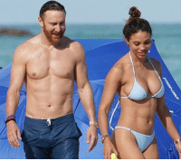 Memes, David Guetta, and Edm: David Guetta shows off his abs while his gf Jessica Ledon shows off her bod and a rock 🥰 👙 tmz davidguetta engaged edm 📷Splash
