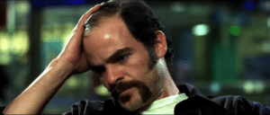 Dawn of the dead (2004) obvious detail: CJ is clearly seen embarrassed about his receding hairline after her throws his hat at the tv.: Dawn of the dead (2004) obvious detail: CJ is clearly seen embarrassed about his receding hairline after her throws his hat at the tv.