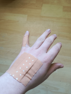 Decided to wake up my cat with belly rubs. He didn't like it as much as usual. Now i can't bend my pinky because of the bandaid, therefore, am unable to reach the shift/ctrl key while gaming.: Decided to wake up my cat with belly rubs. He didn't like it as much as usual. Now i can't bend my pinky because of the bandaid, therefore, am unable to reach the shift/ctrl key while gaming.