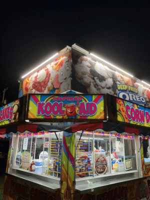 At my local summer fair. How do you deep fry kool aid?: DEEP FRIED  OREO  DEEP FRIED  ROOL AID  FR.C  OREO  Funn Cakes  Funnel Cakes  FUNNEL  CASH  ONLY  Ele hant Ears  Elephant Ears  CAKES  Ghargkery Aye  ppings eadG  O0  $8.00  Toppings  Deep Fried OreoS  Deep Fried Oreos  Deep Fried Twinkle  Deep Fried Twhkle  ocep FHod Candy bar $.00  L00  Deep Fried Candy bar  DEEP  ORE PRIED  OREO  RED  VELVET  LIT  Deep Fried PB&J  A  Daep Fried PB&J  FU IN  Corn Dogs  Carnamon  FUNNL  Cornposs  FUNNEL CAKE  Soft Drinks Icea r.  ed  SoDrinks  Small  .00  LG  Kedls  CAK  Med  SATISFA  LG  mall  Botted Water  TIPS  Bottled Water  Coffee  8DER  AKE At my local summer fair. How do you deep fry kool aid?