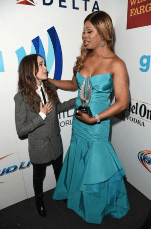 Elf, Target, and Tumblr: DELT  WE  FARG  elOn  0  ODKA  ORL  UD magicmumu:  thatgreenevening:  ellen page is a tiny apologetic menswear elf and laverne cox is a statuesque queen lifting her award in benediction  This looks like the most amazing prom picture ever.