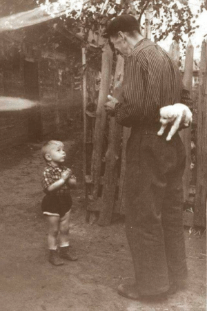 Depression-era father about to surprise his malnourished son with dinner. (1933): Depression-era father about to surprise his malnourished son with dinner. (1933)