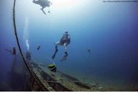 Memes, Petty, and Navy: (Dept of Defense/Petty Officer 3nd Class Allhed A. Coffel U.S. Navy technicians and a member of the Japanese Self Defense Force dive by the wreck of a sunken World War II Japanese freighter off the coast of Guam. ProudAmerican