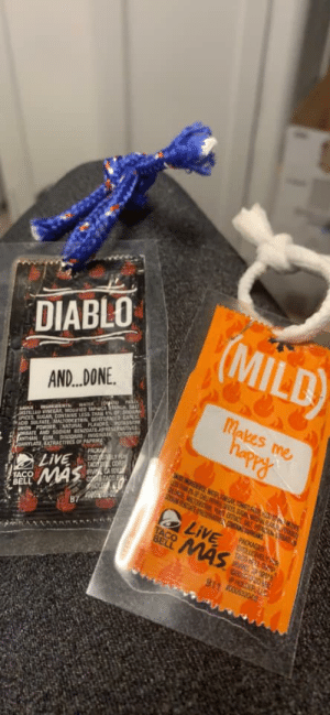 Avon, Christmas, and Taco Bell: DIABLO  (MILD)  AND... DONE  atSTILLED vINEGAR MOUFED TAPHCA TANGH SALT  SICES SUGAI CONTAINS LESS THAN %OF Sno  ACID SALFATEMALTODEETRIN GEHYDRATED GARLIG  avON POWDeR NATURALFLANDRS POTASSI  ARILATE AND SODIUM BENZOATE PRESERVATIVES  ANTHAN GU DISODHM INDSINALE DsODin  uANYLATE EXTRACTIVES OF PAPRIKA  Makes me  hapry  INGREUIENTS  SAICE  PACKA  LIVE  TACOMAS  TAC COR  IRV CA 92  TACO  E NOFDUP ICESSA R  SOCE WTO ECT SALT PC  BELL  0O000  87  LIVE  PACKAGED  TACO  BELL  MAS  TACO  IVIC  C3E20  P HDER L  911 000532002 Taco Bell Christmas ornaments for sale in my area, made from actual trash