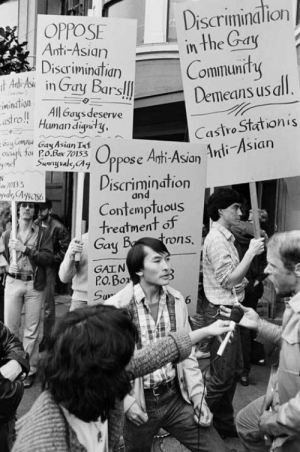 "angrywomenofcolorunited:  blackinasia:  (Image description: Asian americans picketing outside of a gay bar against Anti-Asian discrimination) woc-resist: [TRIGGER WARNING: Racism, transphobia]  commiepinkofag:  Anti-Racism Protest, 1980, Rink Foto. from San Fransisco: The Making of a Queer Mecca 2009 exhibition Curated by Julia Haas with the assistance of Jonathan D. Katz Randy Kikukawa and friends protest the Castro Station Bar for denying him entrance because he was ""small,"" 1980.  i'm glad this showed up on my dash with the context  This is amazing to see, especially since so many people try to pretend as though the blatant racism (and transphobia as well) in the LGBTQ community simply doesn't exist on behalf of ""unity"" around the demands of rich, white gay men. Love this set and it's so emblematic of the intersectional struggles of QPOC even within the lgbtq community.  [TRIGGER WARNING: Racism, transphobia]   As a minority in the gay community I appreciate this post BUT I don't want to label all white gays as rich and not all have the best lives either. Lets be critical and take the middle ground.: Discriminalion  in the Gay  Community  Demeans us all.  OPPOSE  Anti-Asian  Discriminatian  