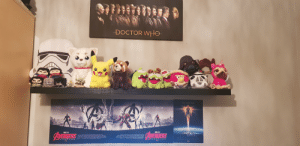 Doctor, Marvel, and Been: DOCTOR WHe  HIGHER PURTHER FASTER  AVENGE TH E FALLEN  AVENDE TH  4LLEN  AREL  CAPTAIN  MARVEL  MARMEL STUDIOS  MARVEL STUDIOS  VENGERS  AYENGERS  ENDGAME  ENDGAME Just wanted to show off my little plush shelf that's been in progress for the past year.